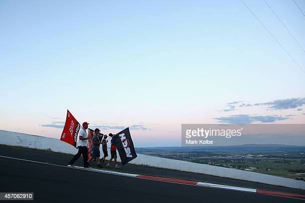 Race fans walk the track at the end of racing during the V8 Supercars Bathurst 1000 weekend at Mount Panorama on October 11 2014 in Bathurst Australia