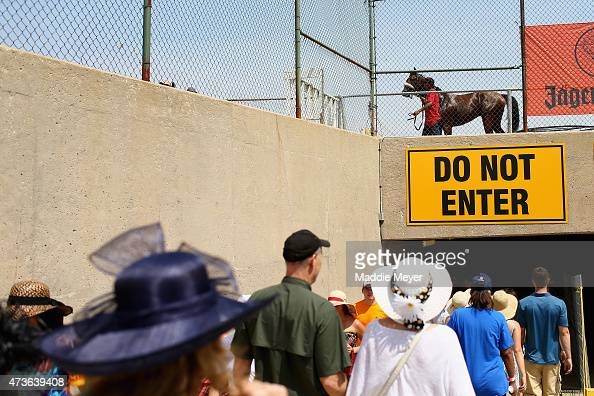 Race fans walk to the infield prior to the 140th running of the Preakness Stakes at Pimlico Race Course on May 16 2015 in Baltimore Maryland