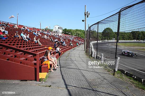 Race fans watch cars practice for the NASCAR Whelen Modified Tour Mr Rooter 161 at Waterford Speedbowl on May 30 2015 in Waterford Connecticut