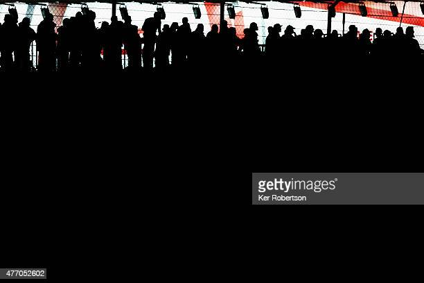 Race fans watch into the night during the Le Mans 24 Hour race at the Circuit de la Sarthe on June 13 2015 in Le Mans France