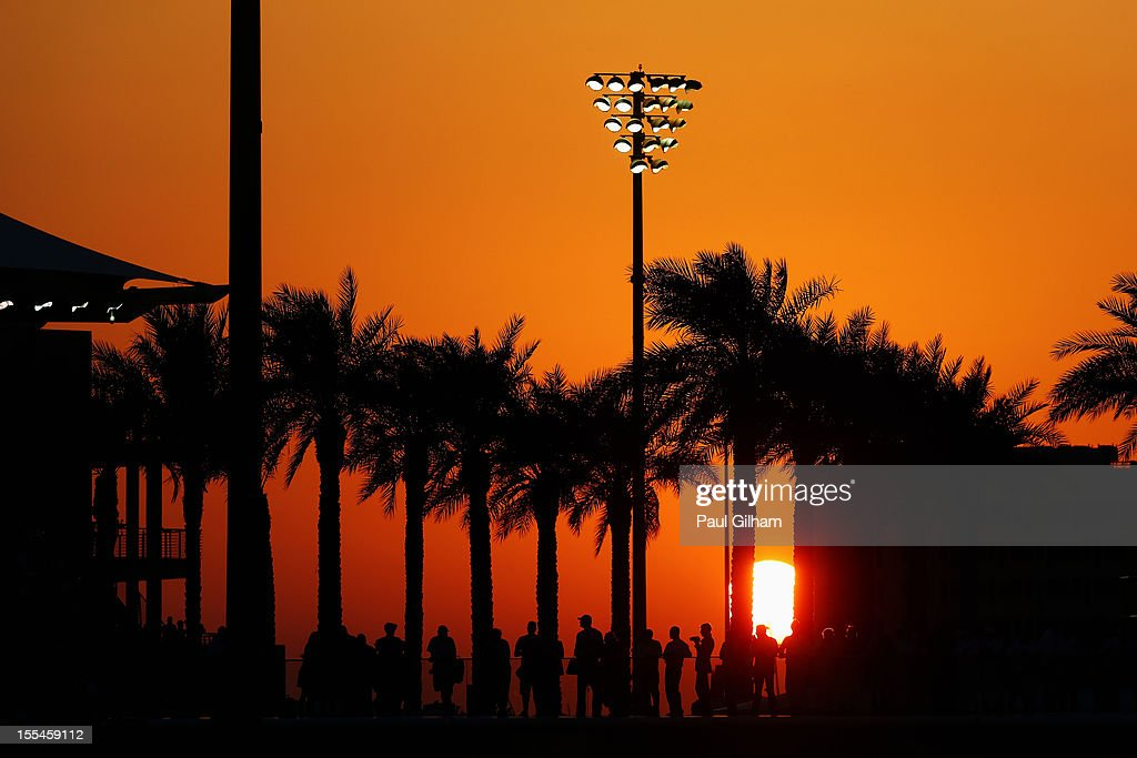 Race fans watch the action as the sun sets during the Abu Dhabi Formula One Grand Prix at the Yas Marina Circuit on November 4, 2012 in Abu Dhabi, United Arab Emirates.