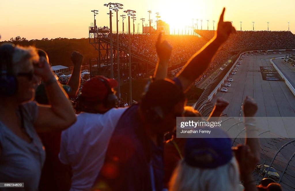 Race fans watch the NASCAR Sprint Cup Series Bojangles' Southern 500 during sunset at Darlington Raceway on September 4, 2016 in Darlington, South Carolina.