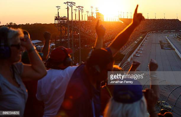 Race fans watch the NASCAR Sprint Cup Series Bojangles' Southern 500 during sunset at Darlington Raceway on September 4 2016 in Darlington South...