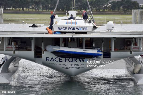 Race for Water foundation hydrogen and solar multihull Race for Water navigates to the docks on April 4 2017 in Lorient a few days prior to the start...