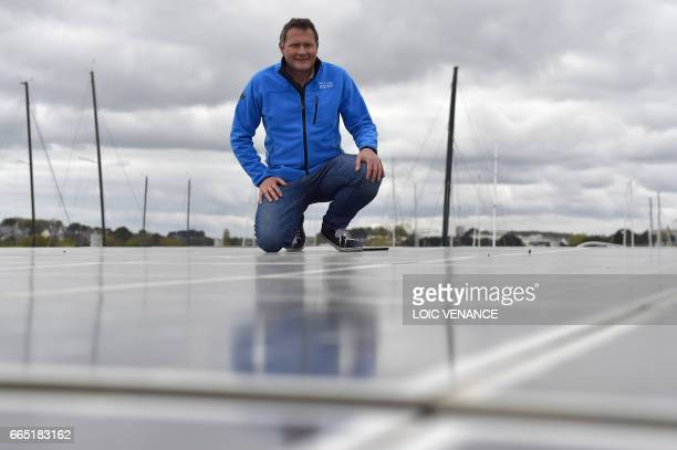 Race for Water foundation president Marco Simeoni poses onboard the hydrogen and solar multihull Race for Water on April 4 2017 in Lorient a few days...