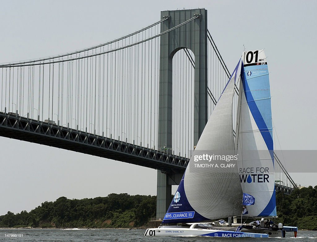 Race For Water goes under the Verrazano-Narrows Bridge at the start in the KRYS Ocean Race near lower Manhattan on July 7, 2012 in New York. Race For Water is one of five sailboats participating in the race, starting in New York and ending in Brest, France.