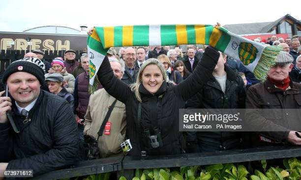 A race goer celebrates after Jockey Noel Fehily and Unowhatimeanharry win The Ladbrokes Champion Stayers Hurdle during day three of the Punchestown...