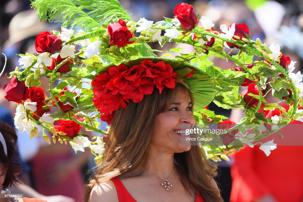 A race goer celebrates the atmosphere on 2017 Oaks Day at Flemington Racecourse on November 9, 2017 in Melbourne, Australia.