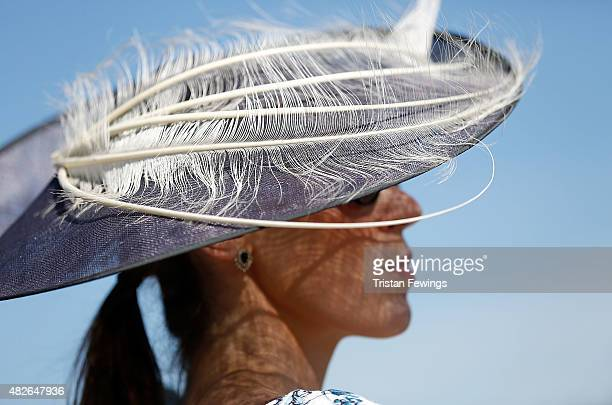 A race goer on day five of the Qatar Goodwood Festival at Goodwood Racecourse on August 1 2015 in Chichester England