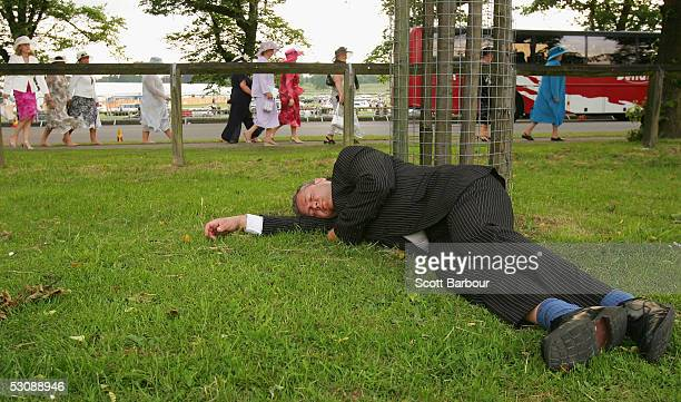 A race goer sleeps after attending the third day Ladies Day of Royal Ascot 2005 at York Racecourse on June 16 2005 in York England One of the...