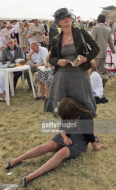A race goer takes a rest at Ladies' Day during the third day of Royal Ascot at the Ascot Racecourse on June 22 2006 in Berkshire England The event...