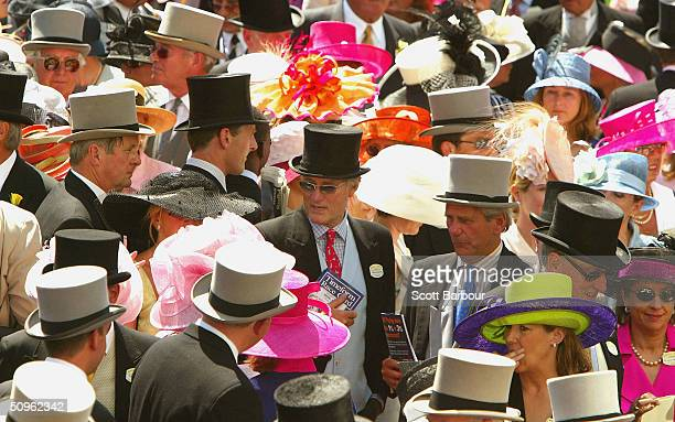 Race goers attend the first day of Royal Ascot at the Ascot Racecourse on June 15 2004 in Berkshire England The event has been one of the highlights...