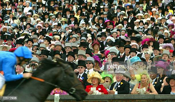 Race goers cheer as Frankie Dettori rides Kheleyf to victory in the first race during the second day of Royal Ascot at Ascot Racecourse on June 16...