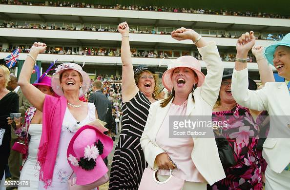 Race goers cheer home their horse during Ladies Day on the third day of Royal Ascot at the Ascot Racecourse on June 17 2004 in Berkshire England The...