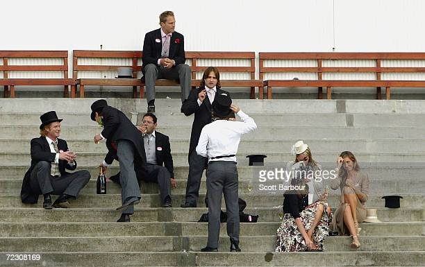 Race goers finsh their champagne after Ladies Day on the third day of Royal Ascot at the Ascot Racecourse on June 17 2004 in Berkshire England The...