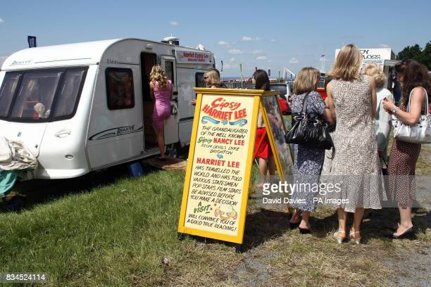 Race goers seek the advice of a fortune teller at Epsom Downs Racecourse Surrey