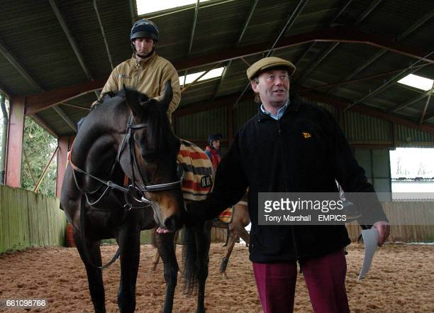 Race horse trainer Nicky Henderson with one of his Cheltenham Festival contenders