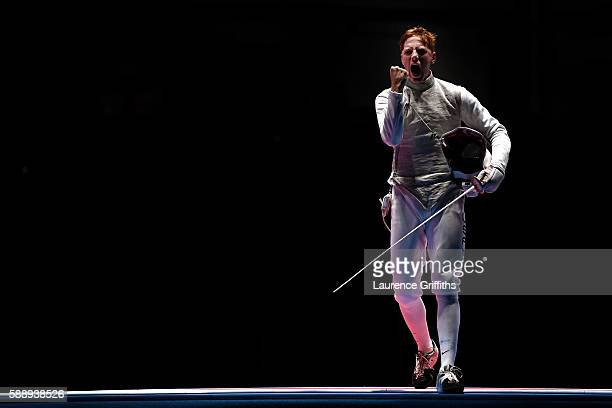 Race Imboden of the United States celebrates against Daniele Garozzo of Italy during the Men's Foil Team Bronze Medal Match bout on Day 7 of the Rio...