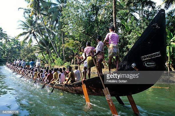 Race in Alappuzha region during the annual harvest festival Onam Chundan Vallam or snake boats are over 100 feet long About one hundred oarsmen board...