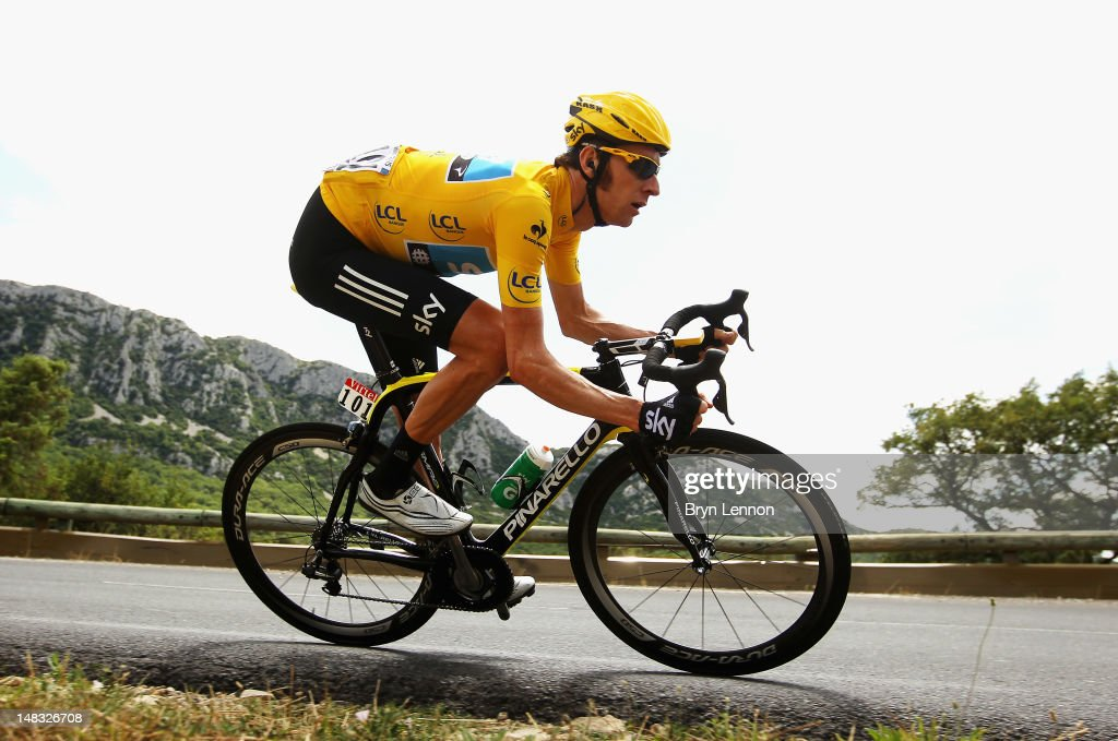Race leader <a gi-track='captionPersonalityLinkClicked' href=/galleries/search?phrase=Bradley+Wiggins&family=editorial&specificpeople=182490 ng-click='$event.stopPropagation()'>Bradley Wiggins</a> of Great Britain and SKY Procycling in action during stage thirteen of the 2012 Tour de France from Saint-Paul Trois Chateaux to Le Cap D'Agde on July 14, 2012 in Le Cap d'Agde, France.