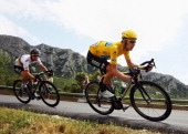 Race leader Bradley Wiggins of Great Britain and SKY Procycling leads team mate Mark Cavendish of Great Britain during stage thirteen of the 2012...