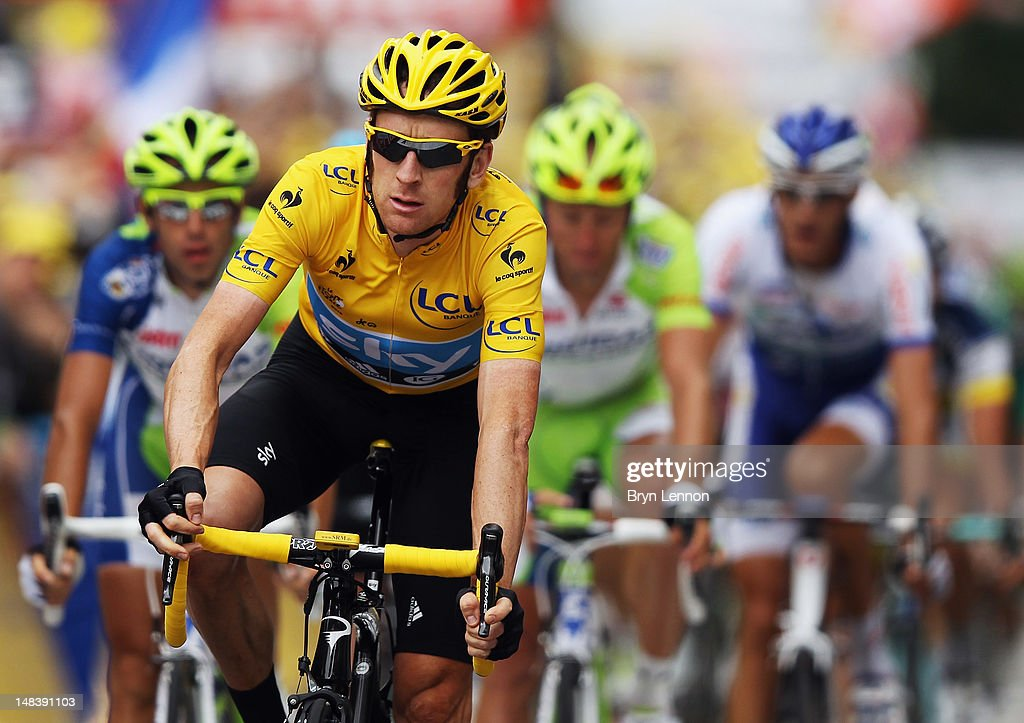 Race leader <a gi-track='captionPersonalityLinkClicked' href=/galleries/search?phrase=Bradley+Wiggins&family=editorial&specificpeople=182490 ng-click='$event.stopPropagation()'>Bradley Wiggins</a> of Great Britain and SKY Procycling crosses the finishline in the peloton on stage fourteen of the 2012 Tour de France from Limoux to Foix on July 15, 2012 in Foix, France.
