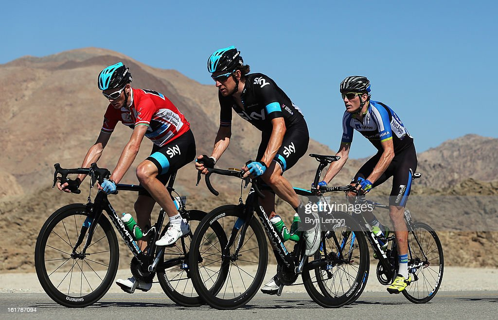 Race leader Chris Froome of Great Britain and SKY Procycling rides with team mate Sir Bradley Wiggins during stage six of the 2013 Tour of Oman from Hawit Nagam Park to the Matrah Corniche on February 16, 2013 in Matrah, Oman.