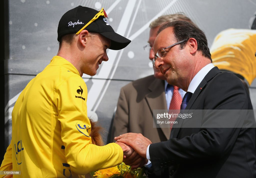 Race leader Chris Froome of Great Britain and Sky Procycling shakes hands with French President Francois Hollande (R) after stage nine of the 2013 Tour de France, a 168.5KM road stage from Saint-Girons to Bagneres-de-Bigorre, on July 7, 2013 in Bagneres-de-Bigorre, France.