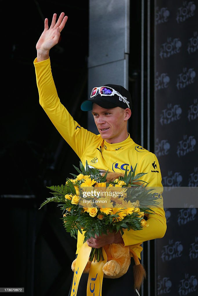 Race leader <a gi-track='captionPersonalityLinkClicked' href=/galleries/search?phrase=Chris+Froome&family=editorial&specificpeople=5428054 ng-click='$event.stopPropagation()'>Chris Froome</a> of Great Britain and Team Sky Procycling celebrates on the podium after winning stage eight of the 2013 Tour de France, a 195KM road stage from Castres to Ax 3 Domaines, on July 6, 2013 in Ax 3 Domaines, France.