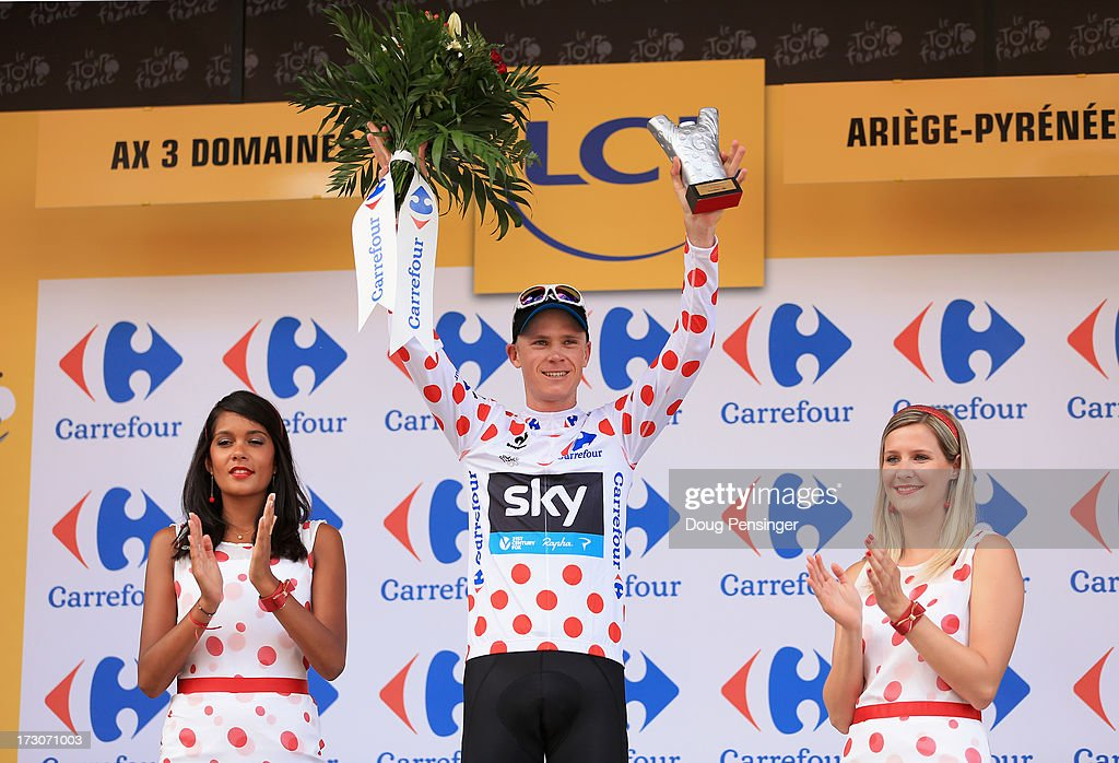 Race leader <a gi-track='captionPersonalityLinkClicked' href=/galleries/search?phrase=Chris+Froome&family=editorial&specificpeople=5428054 ng-click='$event.stopPropagation()'>Chris Froome</a> of Great Britain and Team Sky Procycling celebrates on the podium wearing the King of the Mountain (polka dot) jersey after winning stage eight of the 2013 Tour de France, a 195KM road stage from Castres to Ax 3 Domaines, on July 6, 2013 in Ax 3 Domaines, France.