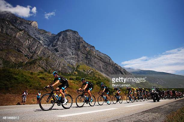 Race leader Chris Froome of Great Britain and Team Sky rides with team mates amongst the peloton during the twentieth stage of the 2015 Tour de...