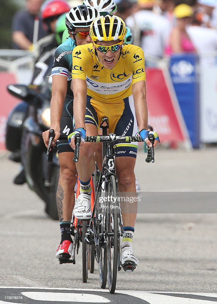 Race leader <a gi-track='captionPersonalityLinkClicked' href=/galleries/search?phrase=Daryl+Impey&family=editorial&specificpeople=8630837 ng-click='$event.stopPropagation()'>Daryl Impey</a> of South Africa and Team Orica GreenEdge finishes Stage Eight of the Tour de France 2013 - the 100th Tour de France -, a 195 km road stage from Castres to Ax 3 Domaines on July 6, 2013 in Ax 3 Domaines, France.