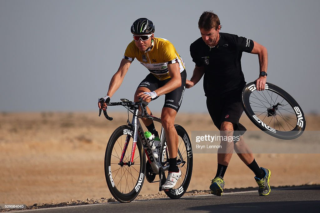 Race leader Edvald Boasson Hagen of Norway and Dimension Data receives assitance from his mechanic after suffering a rear puncture earlier in the stage on stage four of the 2016 Tour of Qatar, a 189km road stage from Al Zuberah Fort to Madinat Al Shama, on February 11, 2016 in Madinat Al Shamal, Qatar.