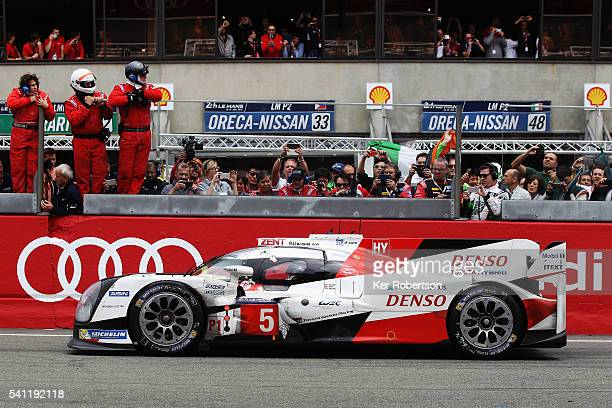 Race leader Kazuki Nakajima of Toyota Gazoo Racing suffers engine problems on the main straight at the end of the Le Mans 24 Hour race handing...