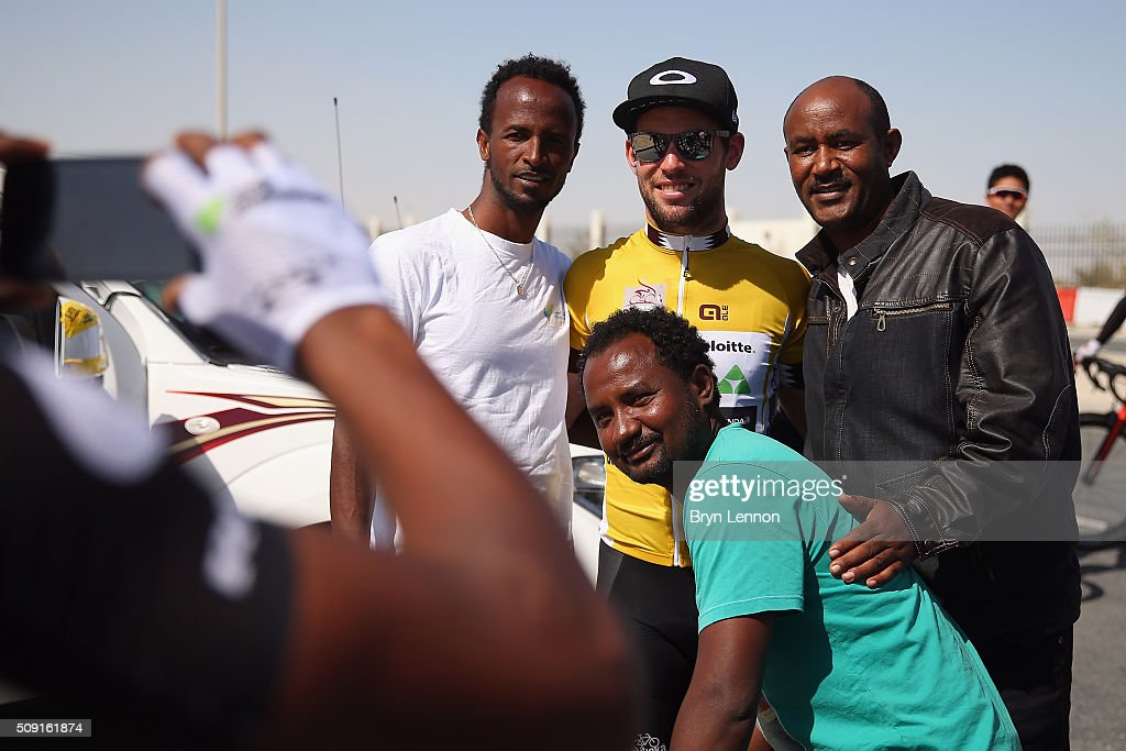 Race leader <a gi-track='captionPersonalityLinkClicked' href=/galleries/search?phrase=Mark+Cavendish&family=editorial&specificpeople=684957 ng-click='$event.stopPropagation()'>Mark Cavendish</a> of Great Britain and Dimension Data poses for a photo with fans at the start of stage two of the 2016 Tour of Qatar from Qatar University to Qatar Univeristy on February 9, 2016 in Doha, Qatar. The stage also serves as a test event for the World Road Race Championships which will be held in Doha in October.