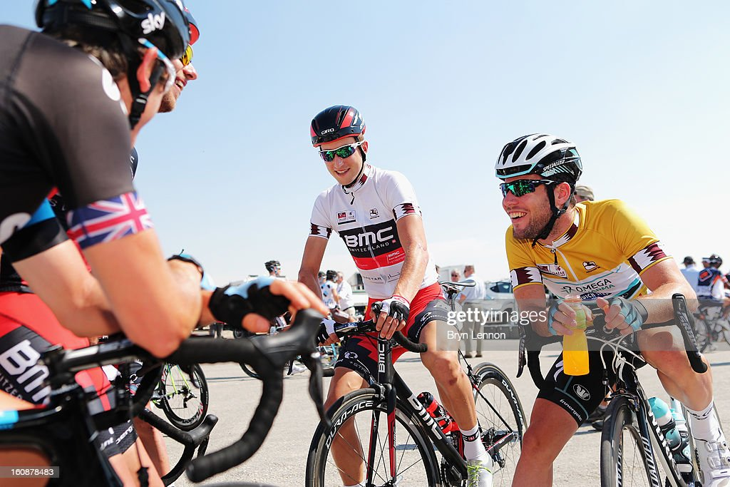 Race leader <a gi-track='captionPersonalityLinkClicked' href=/galleries/search?phrase=Mark+Cavendish&family=editorial&specificpeople=684957 ng-click='$event.stopPropagation()'>Mark Cavendish</a> (r) of Great Britain and Omega Pharma - Quick Step laughs at the start of stage five of the 2013 Tour of Qatar from Al Zubara Fort to Madinat Al Shamal on February 7, 2013 in Al Zubara Fort, Qatar.