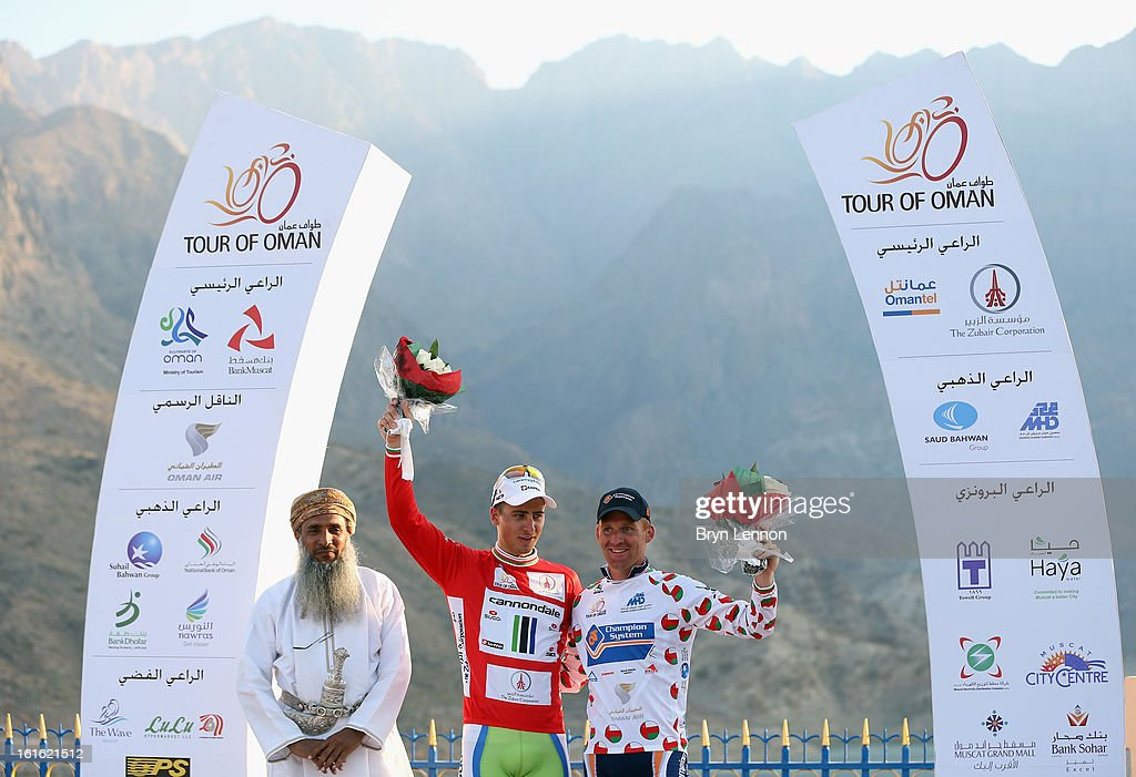 Race leader <a gi-track='captionPersonalityLinkClicked' href=/galleries/search?phrase=Peter+Sagan&family=editorial&specificpeople=4846179 ng-click='$event.stopPropagation()'>Peter Sagan</a> of Slovakia and Cannondale and most agressive rider Bobbie Traksel of the Netherlands and Champion System stands on the podium after stage three of the 2013 Tour of Oman from Nakhal Fort to Wadi Dayqah Dam on February 13, 2013 in Wadi Dayqah Dam, Oman.