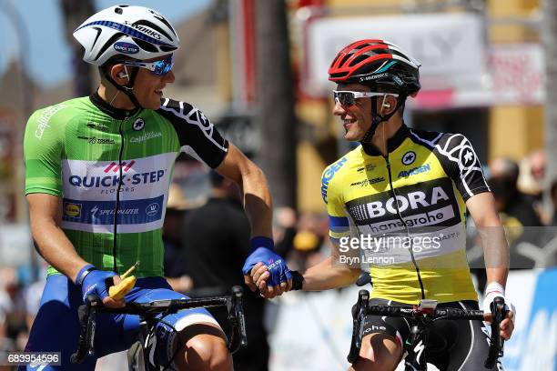 Race leader Rafal Majka of Poland and BoraHansgrohe shakes hands with Marcel Kittel of Germany and QuickStep Floors climbs in the peloton on stage 3...