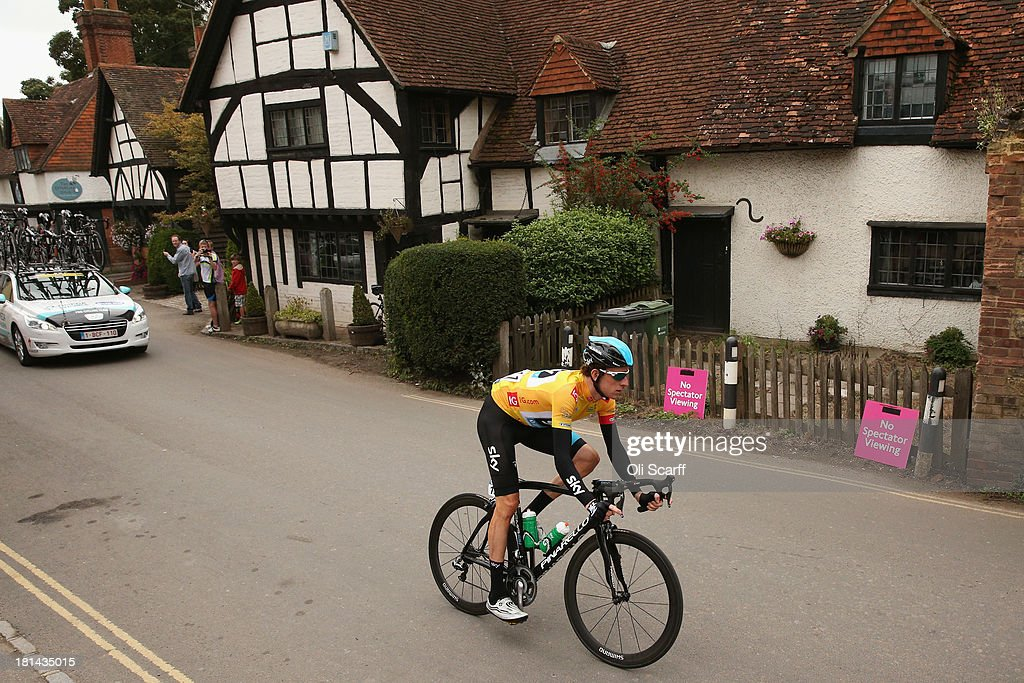 Race leader Sir Bradley Wiggins passes through the small village of Shere during stage seven of the Tour of Britain from Epsom Racecourse to Guildford on September 21, 2013 in Shere, England. Today's 155km stage is the penultimate one before the race concludes in central London tomorrow. Sir Bradley Wiggins, riding for Team Sky Procycling, currently leads the race beginning today's stage with a 32 second advantage.