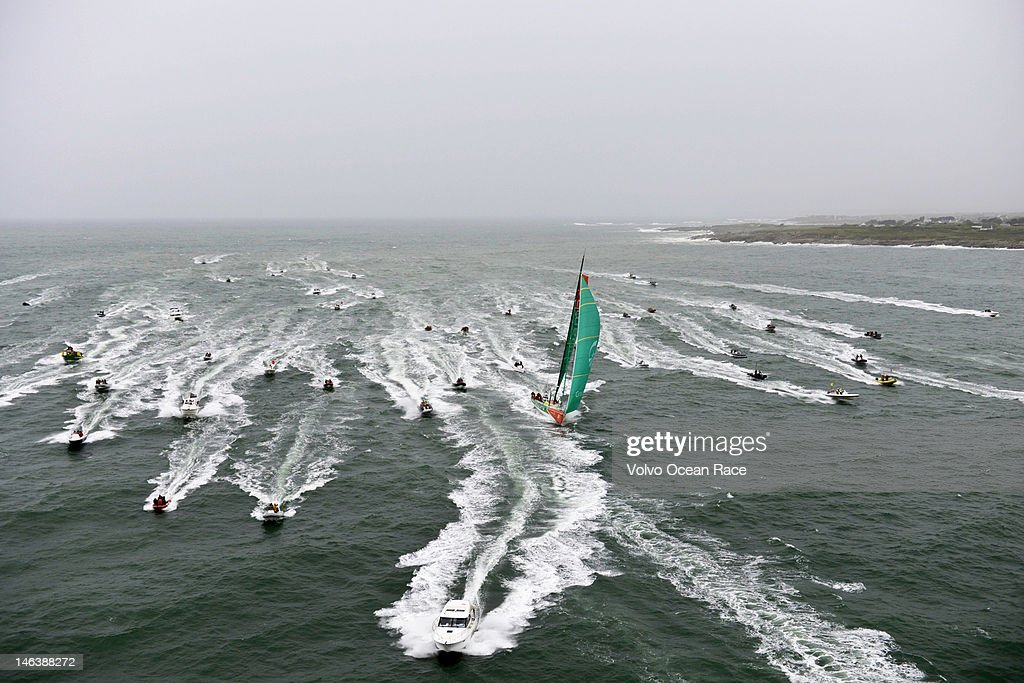 Race leaders Groupama Sailing Team, skippered by <a gi-track='captionPersonalityLinkClicked' href=/galleries/search?phrase=Franck+Cammas&family=editorial&specificpeople=773410 ng-click='$event.stopPropagation()'>Franck Cammas</a> from France, are followed across the line by a huge spectator fleet, to take first place on leg 8, from Lisbon, Portugal, to Lorient, France on June 15, 2012 during the Volvo Ocean Race 2011-12.