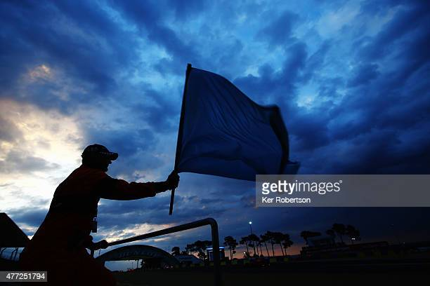 Race marshall at work at the Dunlop Bridge at sunrise during the Le Mans 24 Hour race at the Circuit de la Sarthe on June 14 2015 in Le Mans France