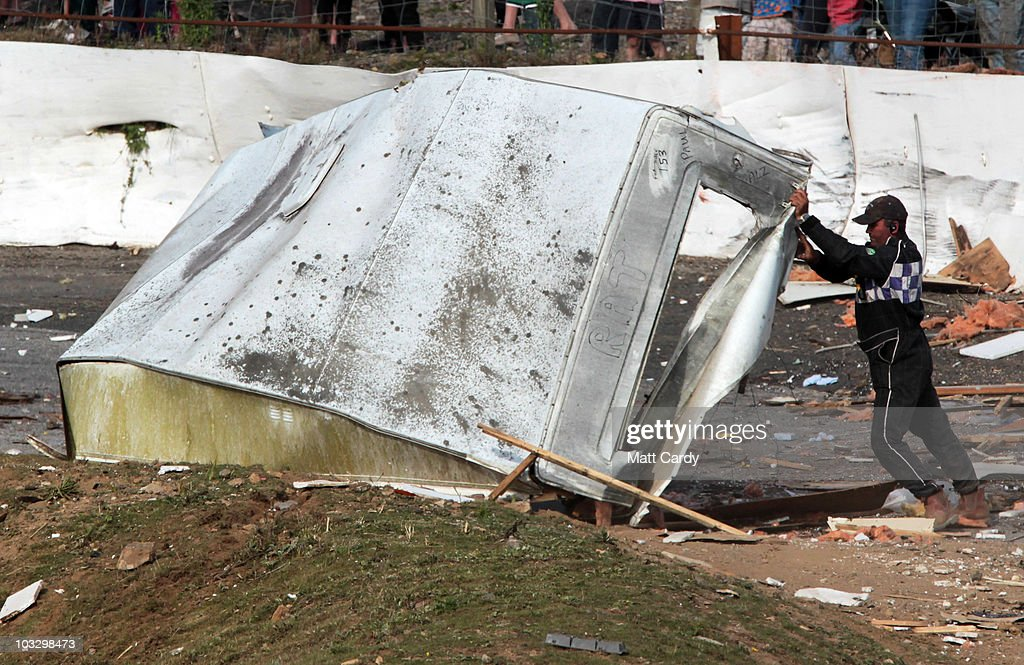 A race marshall moves some of the wreckage of a old caravan destroyed in the annual Cornish Caravan Chaos at United Downs Raceway on August 8 2010...