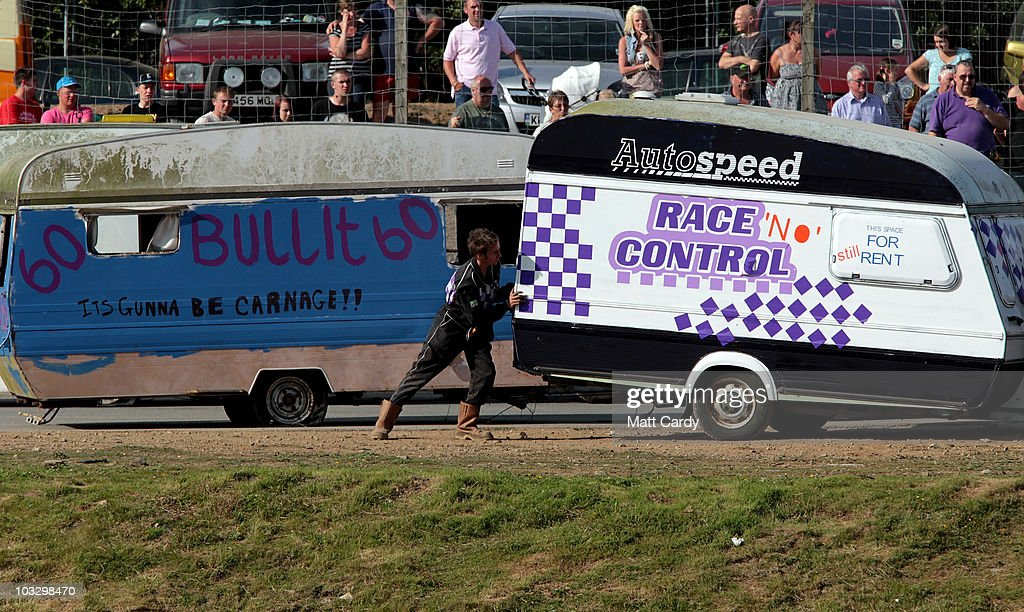 A race marshall tries to move an old caravan as it competes in the annual Cornish Caravan Chaos at United Downs Raceway on August 8 2010 near Redruth...