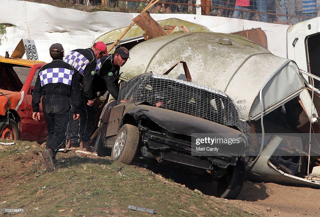 Race marshalls check on a banger racer who has just crashed into the wreckage of old caravans destroyed in the annual Cornish Caravan Chaos at United...