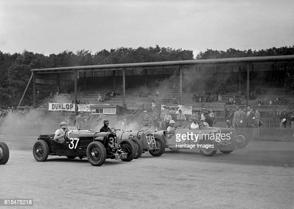 Race meeting at Donington Park Leicestershire 1936 Left Aston Martin 1935 1496 cc Vehicle Reg No CMF764 Event Entry No 37 Centre Vale Special Event...