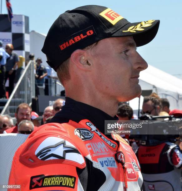 Race One winner Chaz Davies Ducati Panigale R Arubait Racing Ducati is interviewed by the media in victory lane at the SBK/MOTUL FIM Superbike World...