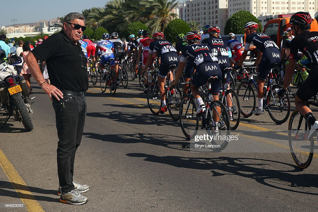 Race Organiser Eddy Merckx watches the peloton ride slowly across the finish line after the stage was cancelled due to safety concerns on stage 5 of the 2015 Tour of Oman, a 151.5km road stage from Al Sawadi Beach to Ministry of Housing on February 21, 2015 in Muscat, Oman.