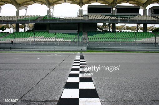 Race track finish line with empty seats : Stock Photo