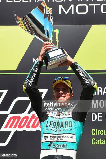 Race winer Leopard Racing Spanish rider Joan Mir celebrates on the podium with the trophy of the Moto3 race of the Catalunya Grand Prix at the...