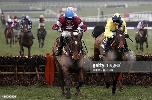 Race winner Adrian Heskin riding Martello Tower jumps the last hurdle during the Albert Bartlett Novices' Hurdle Race on the final day of the...